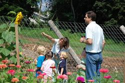 Two adults and three children looking around the Sugartown Garden