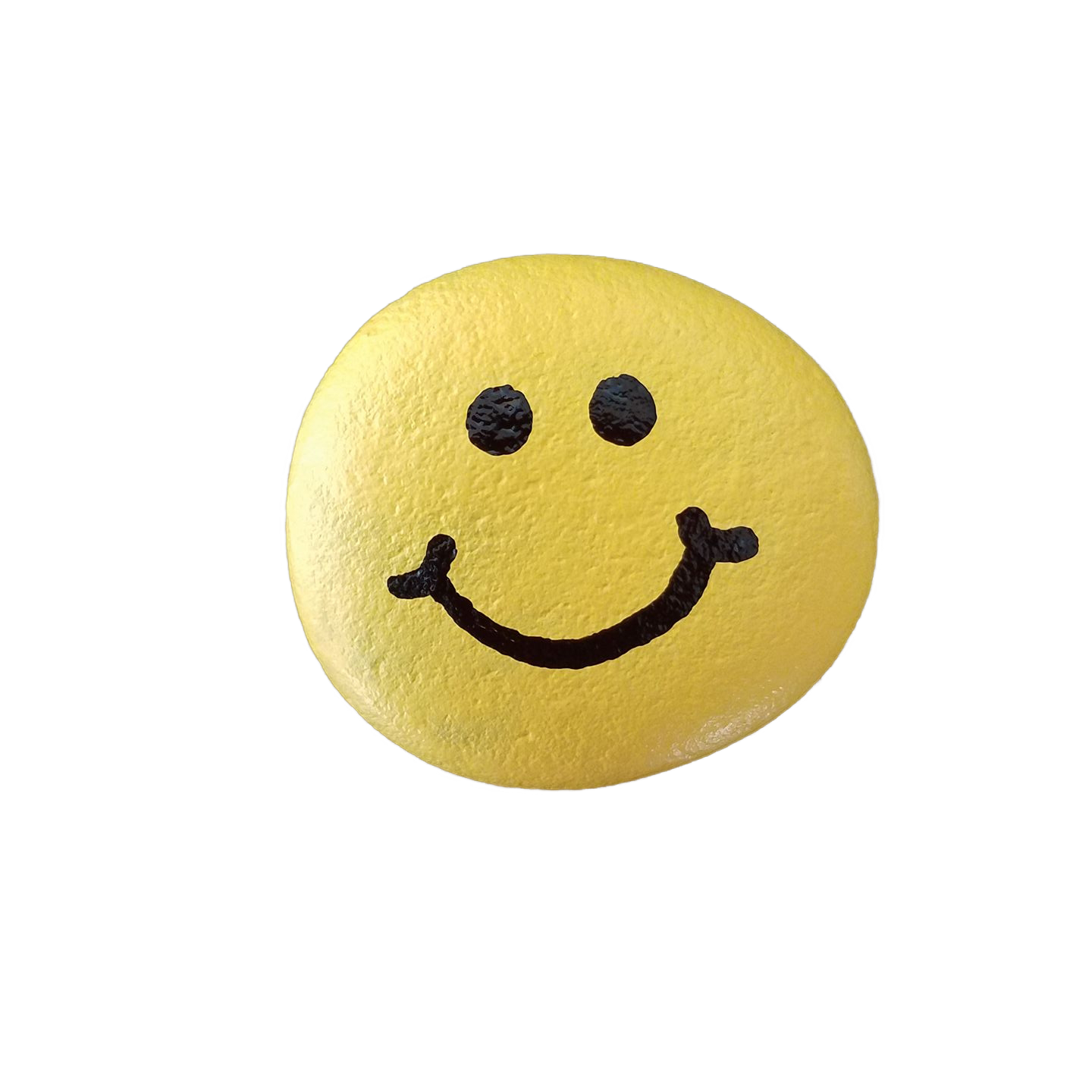 A rock painted yellow with a smiley face on it